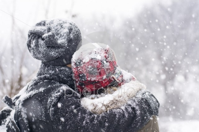 Couple in love outdoors hugging on a winter day