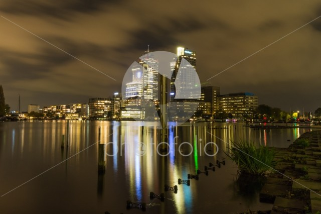 The Amsterdam city center and AMstel river by night