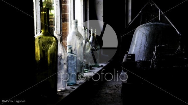 Glass bottles on a window ledge
