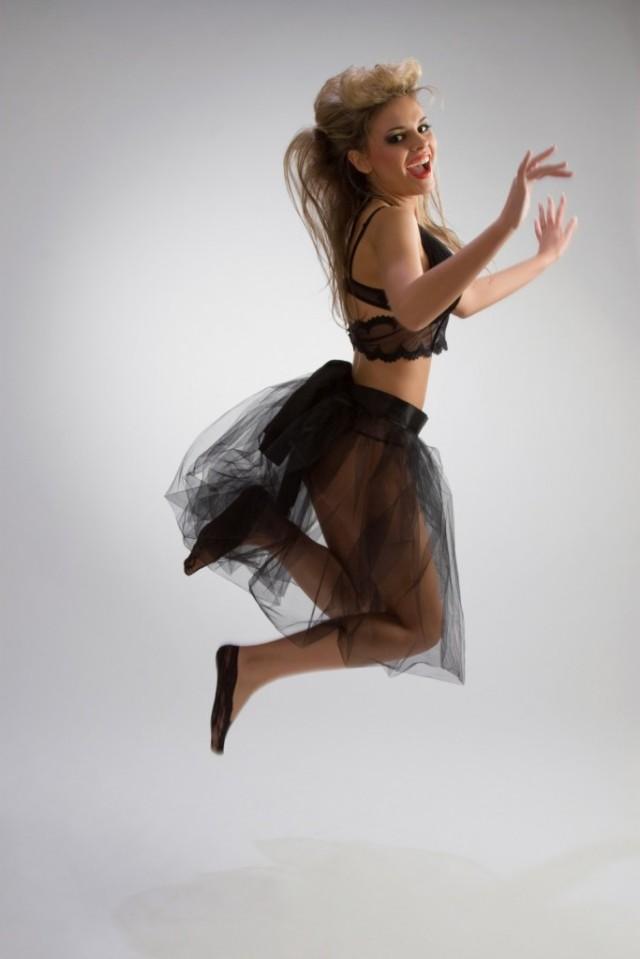 Beautiful girl in diaphanous skirt