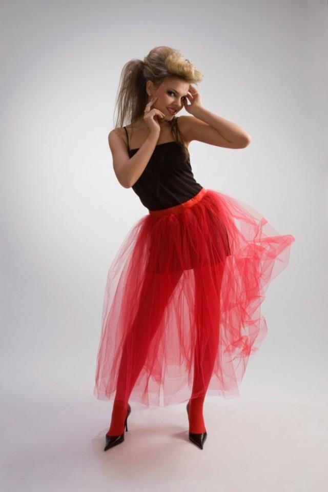 Beautiful girl in red skirt