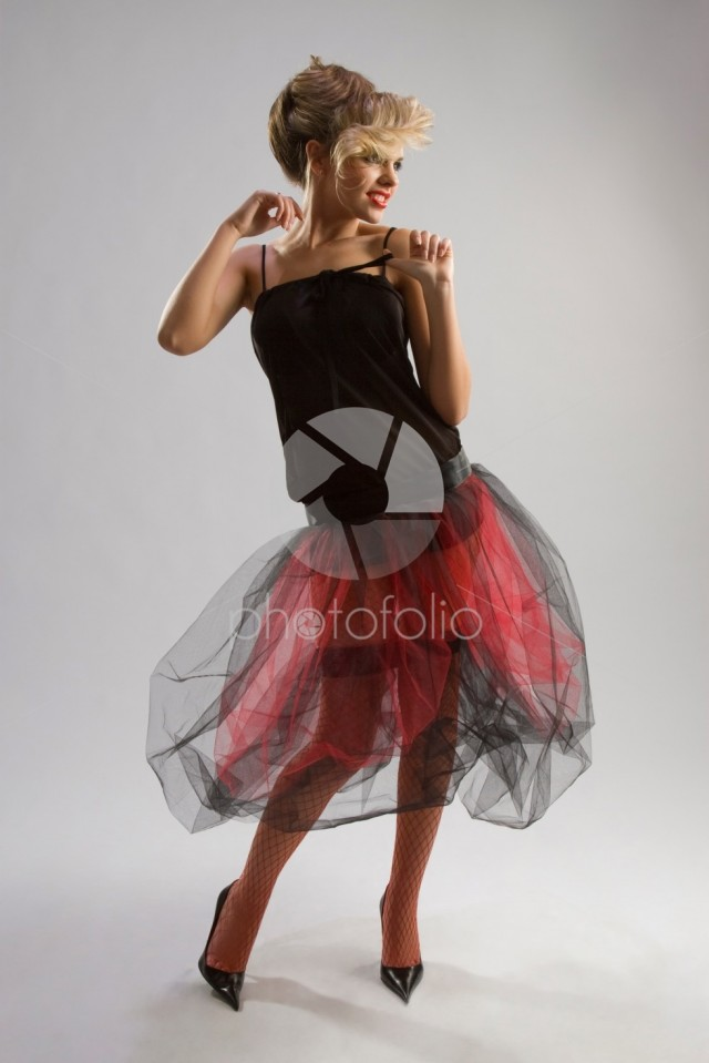 Beautiful girl in diaphanous skirt