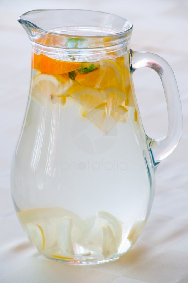 Pitcher with water and fruits