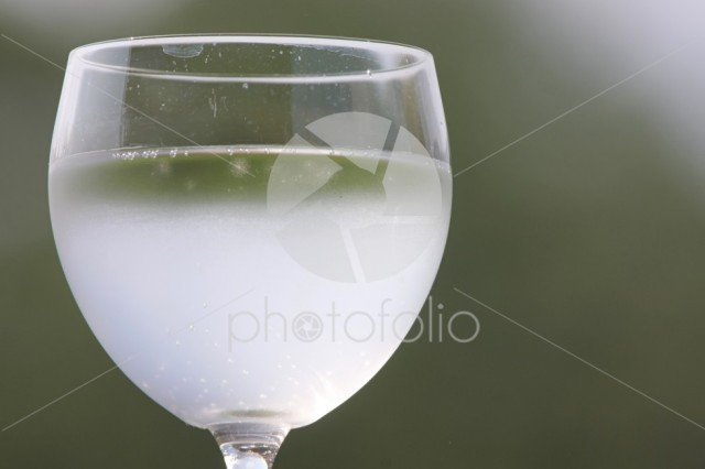 Glass with drink.