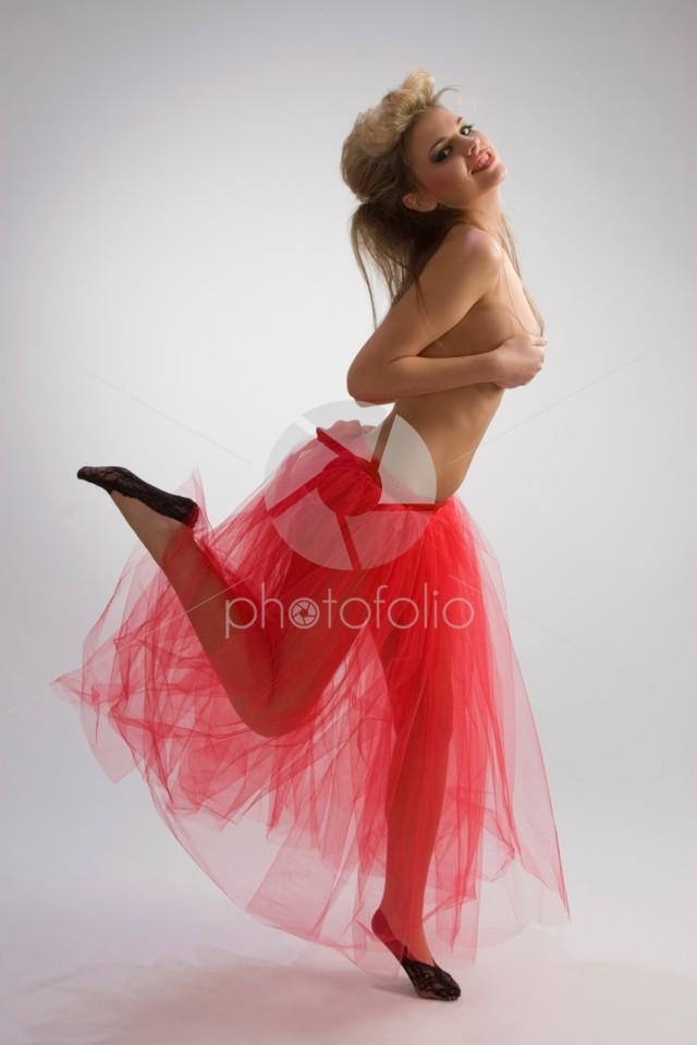Dancing girl in red skirt