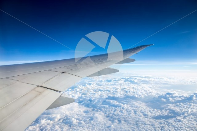 Amazing clear blue sky and cloud from window of an aeroplane