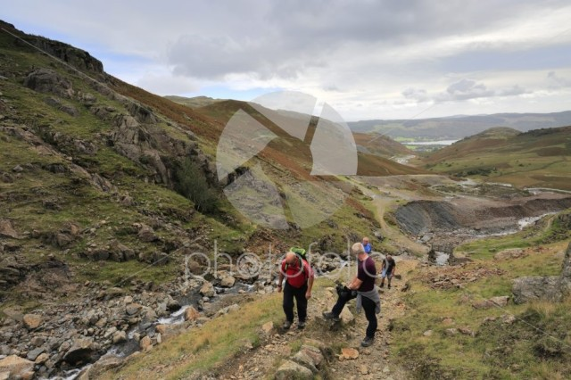 Walkers in the Copper Mines Valley above Coniston town