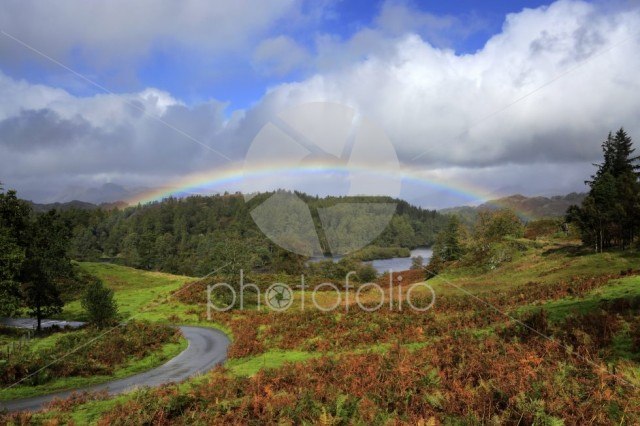 Autumn rainbow over Tarn Hows, Lake District National Park
