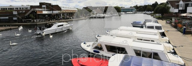 Pleasure boats on the River Bure at Wroxham town in the Norfolk