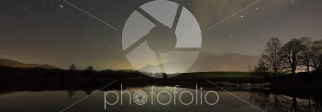 Star trails over Derwentwater, Keswick town, Lake District