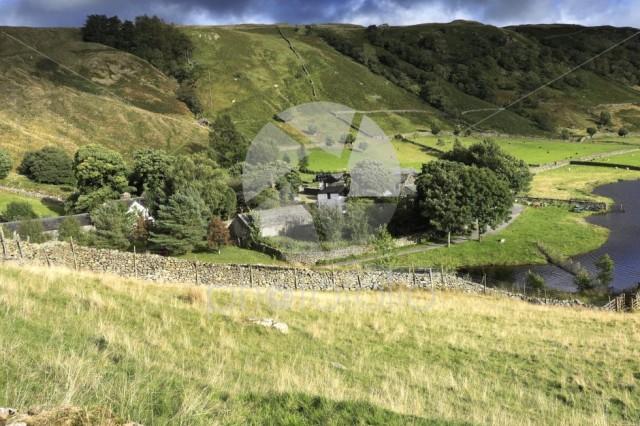 Summer view over Watendlath Tarn farm, Lake District
