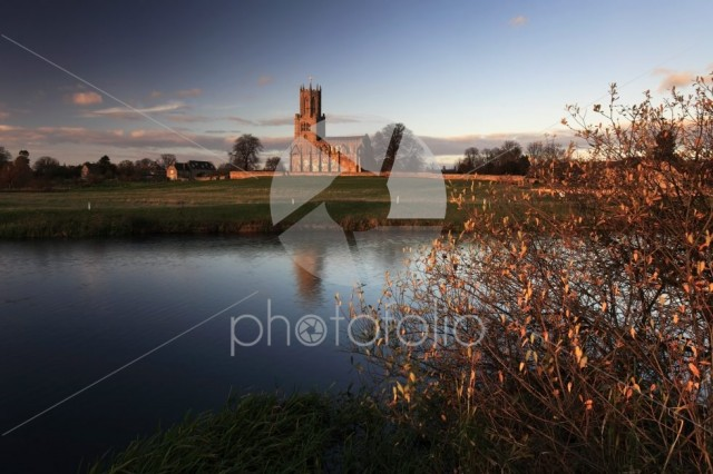Autumn sunset, river Nene; St Marys church, Fotheringhay village