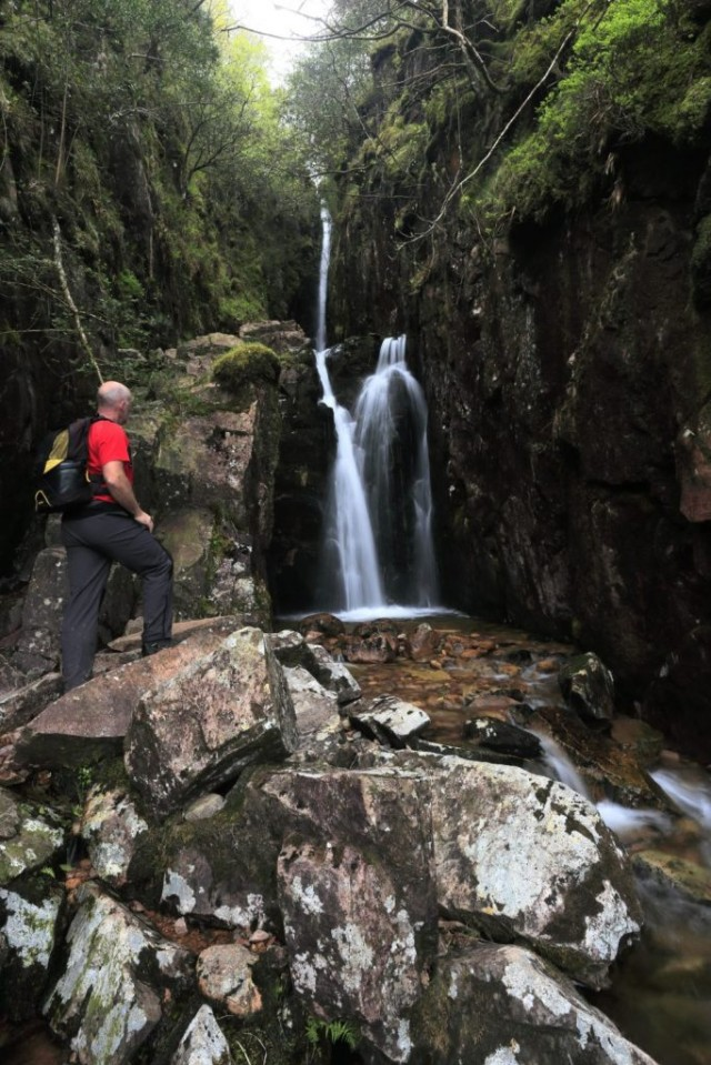 Walker at Scale Force waterfall, Buttermere valley Lake District