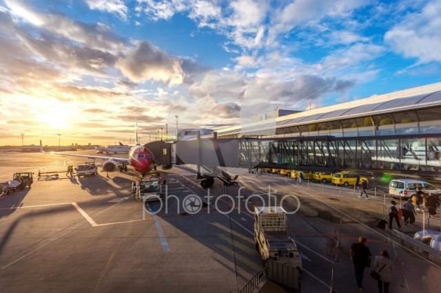 Passenger walk to plane on taxi gate for travel and transportation with service car at Copenhagen airport