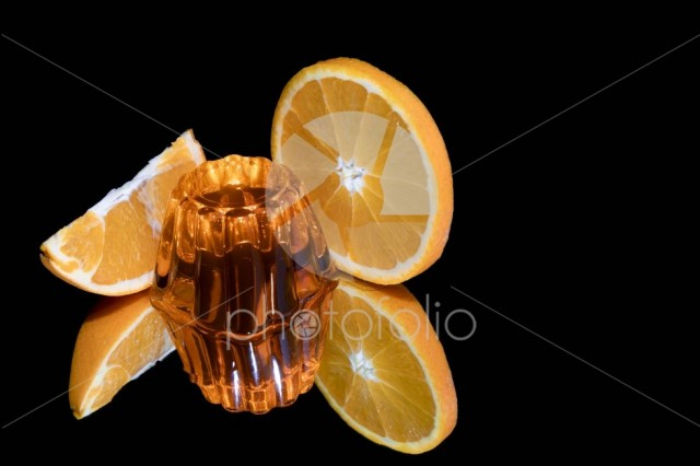 Orange jelly and fresh fruits isolated
