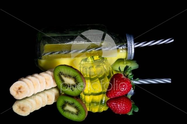 Orange juice , lemon jelly and fresh fruit  isolated