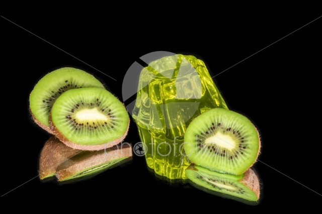 Kiwi jelly with fresh kiwi slices isolated