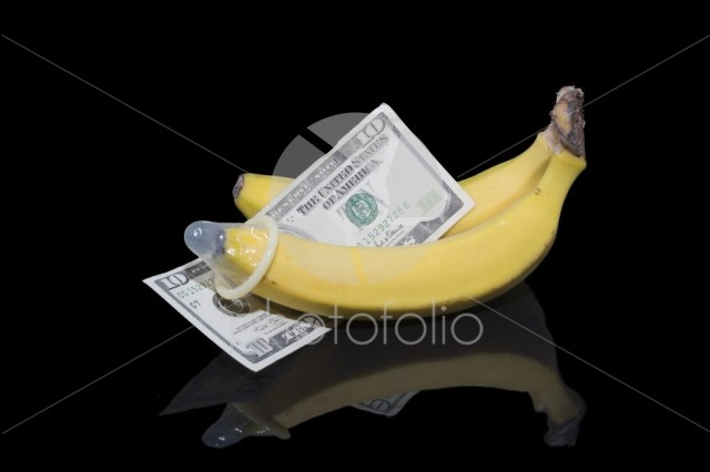 Two bananas and money with a condom