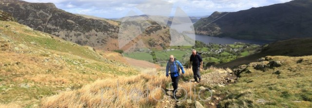 Walkers above Glenridding village and Ullswater lake