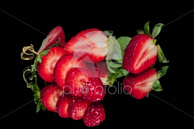 Strawberries on reflective surface