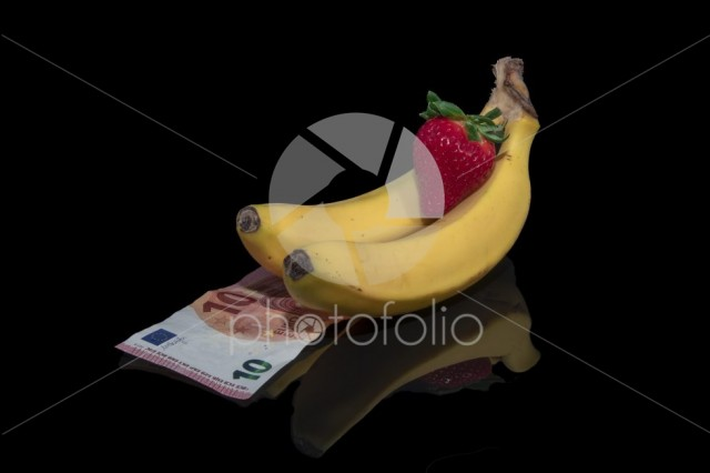 Bananas ,strawberry and money with reflection