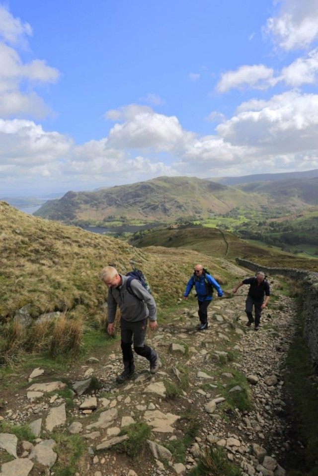 Walkers on Patterdale Common and Ullswater lake, Lake District