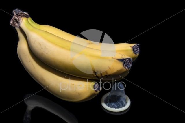 Three bananas with a condom