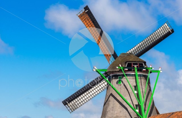 Windmill in agriculture farm with clear blue sky at Zaanse Schan