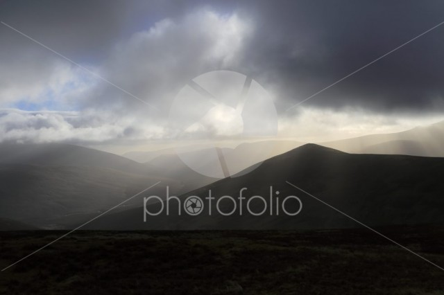 Moody clouds over the Summit of Great Calva fell, Uldale Fells