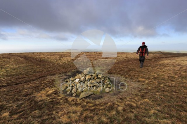 Walker at the Summit cairn on Great Sca fell, Uldale Fells