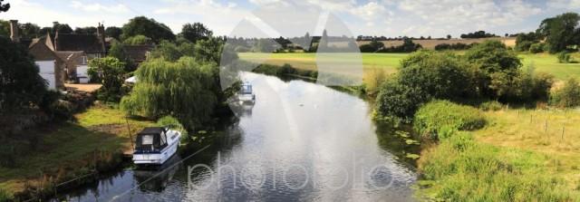 Summer, boat on the river Nene, Wansford village, Cambridgeshire