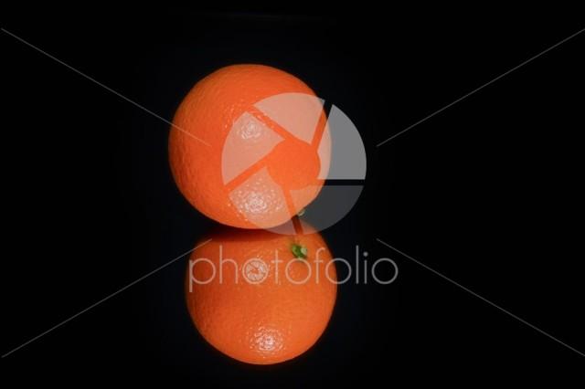 Whole orange and reflection