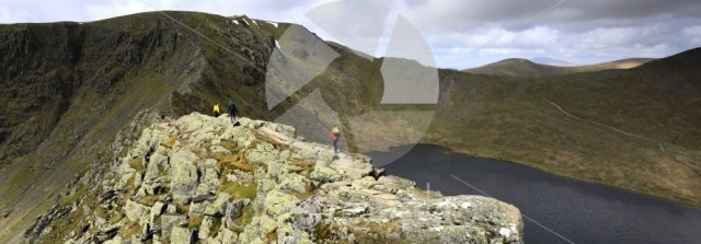Walkers on Striding Edge ridge on the way to Helvellyn fell