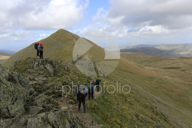 Walkers on Swirral Edge on the way from Helvellyn fell
