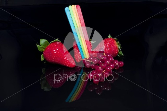 Strawberries and currants with rainbow flag color