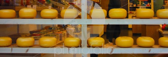 Dutch cheese forms on show in the windows of amsterdam tourist shops. enogastronomic product typical of the Netherlands