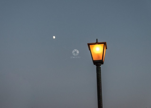 Street light under the moon
