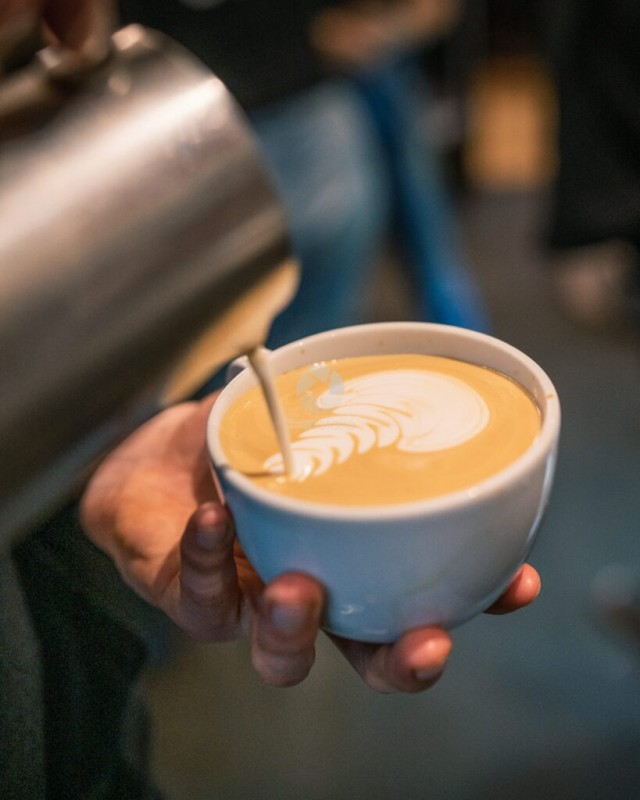 Milk Pouring into Coffee Cup Espresso To Make Latte Art