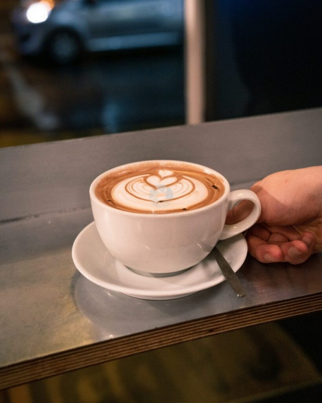 Cup of Cafe Latte with Latte Art on Table
