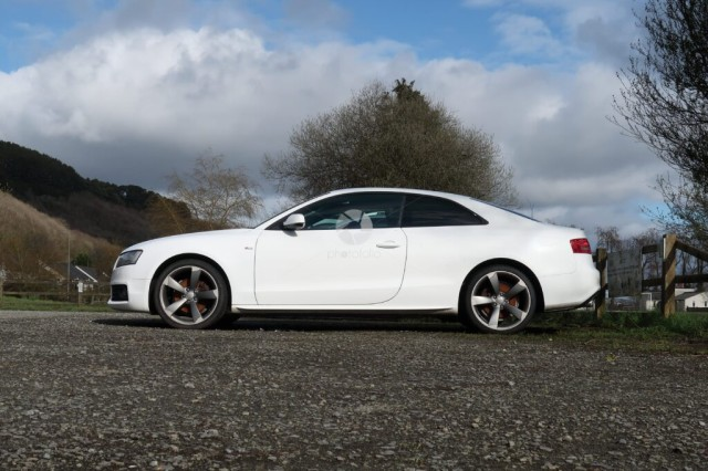 A sporty Audi two door coupe in a public parking area near Pendine Carmarthenshire Wales UK
