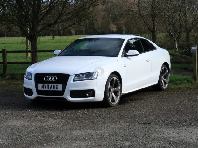 A stylish Audi sports coupe in a public carpark in west Wales UK