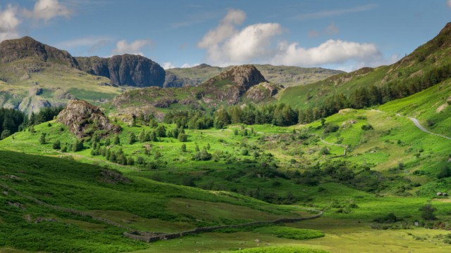 Aerial of Blea Moss and Blea Tarn with the Langdales in the background the English Lake District UK