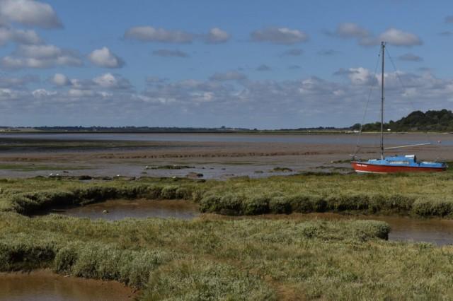 Sailing boat stranded on salt Marsh at Alresford Creek on the River Colne