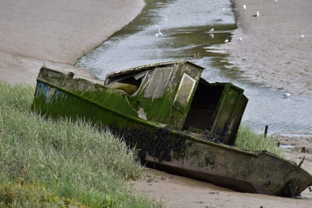 Wrecked boat on River Colne