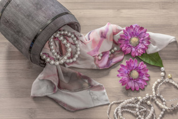 Still life details, scarf and pearls in retro vintage wooden box