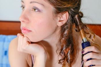Girl straightening her hair