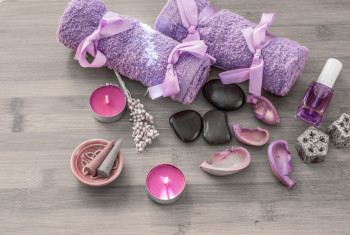 Spa concept. Lavender oil, lavender flowers and bath white and purple towels