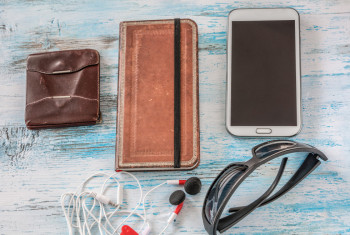 Travel concept with wallet ,book,cell phone,glasses and headset