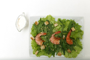 Shrimp salad on white plate