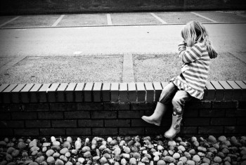 Little girl on a wall